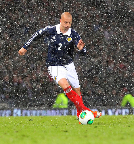 22.03.2013 Glasgow, Scotland. Alan Hutton of Scotland   in action during the World Cup Group A Qualifier between Scotland and Wales from Hampden Park.