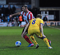 Lincoln City's Matt Rhead vies for possession with Chester's Tom Shaw<br /> <br /> Photographer Andrew Vaughan/CameraSport<br /> <br /> Vanarama National League - Lincoln City v Chester - Tuesday 11th April 2017 - Sincil Bank - Lincoln<br /> <br /> World Copyright &copy; 2017 CameraSport. All rights reserved. 43 Linden Ave. Countesthorpe. Leicester. England. LE8 5PG - Tel: +44 (0) 116 277 4147 - admin@camerasport.com - www.camerasport.com