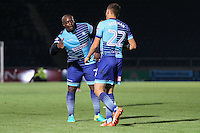 Adebayo Akinfenwa of Wycombe Wanderers congratulates Nick Freeman of Wycombe Wanderers on scoring his team's 3rd goal to make it 3-0 during the The Checkatrade Trophy match between Wycombe Wanderers and West Ham United U21 at Adams Park, High Wycombe, England on 4 October 2016. Photo by David Horn.