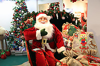 Pictured: A Father Christmas figure in a sleigh in the showroom. Thursday 16 November 2017<br /> Re: Festive company which manufactures tinsel in Cwmbran, Wales, UK.