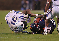 Duke linebacker Vincent Rey (31) helmet comes off while tackling Virginia FB Rashawn Jackson (31) during an ACC football game Saturday in Charlottesville, VA. Duke won 28-17. Photo/Andrew Shurtleff