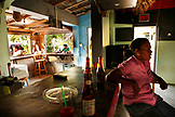 BELIZE, Hopkins, people drink beer at a local bar in Hopkins