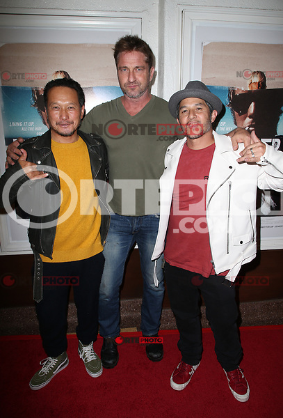 SANTA MONICA, CA - NOVEMBER 1: Takuji Masuda, Gerard Butler, Christian Hosoi, at the Los Angeles Premiere of documentary Bunker77 at the Aero Theater in Santa Monica, California on November 1, 2017. Credit: Faye Sadou/MediaPunch /NortePhoto.com