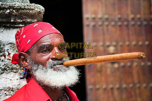 Old man with a long cigar in his mouth, Plaza de la Catedral, Havana, La Habana Vieja, Cuba
