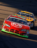 Nov 13, 2005; Phoenix, Ariz, USA;  Nascar Nextel Cup driver Jeremy Mayfield driver of the #19 Dodge Charger leads Matt Kenseth during the Checker Auto Parts 500 at Phoenix International Raceway. Mandatory Credit: Photo By Mark J. Rebilas