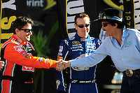 Nov. 16, 2008; Homestead, FL, USA; NASCAR Sprint Cup Series former champion Tony Stewart (left) greets Richard Petty (right) as Kurt Busch looks on during the Ford 400 at Homestead Miami Speedway. Mandatory Credit: Mark J. Rebilas-