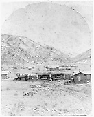 D&amp;RG freight train near Poncha Junction depot and section house.<br /> D&amp;RG  Poncha Springs * [likely Poncha Junction], CO  Taken by Kuykendall, Frank