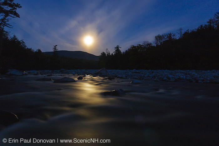 Full moon on a cloudy night over the East Branch of the Pemigewasset River in Lincoln, New Hampshire.