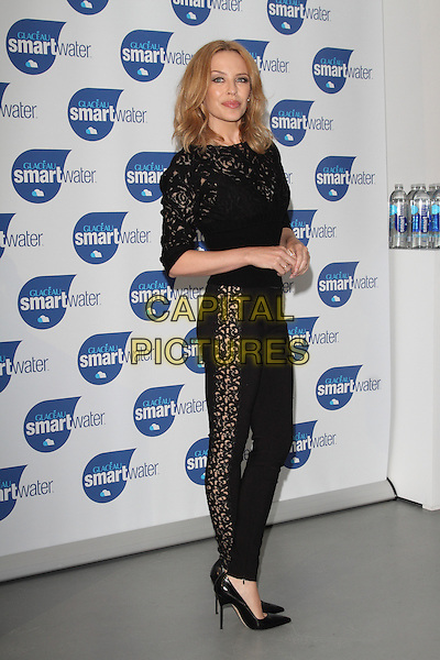 LONDON, ENGLAND - AUGUST 28: Kylie Minogue attends a photocall to launch Glaceau Smartwater at The Dairy Art Centre on August 28, 2014 in London, England<br /> CAP/ROS<br /> &copy;Steve Ross/Capital Pictures