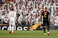 26th February 2020; Estadio Santiago Bernabeu, Madrid, Spain; UEFA Champions League Football, Real Madrid versus Manchester City; Thibaut Courtois (Real Madrid) with a diving save to stop the shot