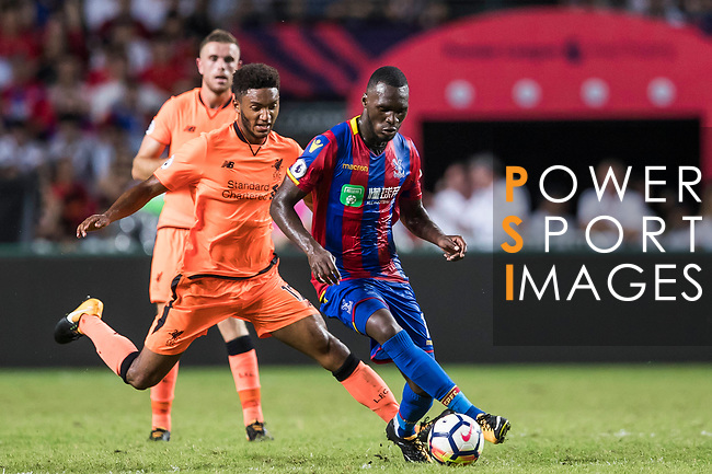 Crystal Palace forward Christian Benteke (R) fights for the ball with Liverpool FC defender Joseph Gomez (L) during the Premier League Asia Trophy match between Liverpool FC and Crystal Palace FC at Hong Kong Stadium on 19 July 2017, in Hong Kong, China. Photo by Yu Chun Christopher Wong / Power Sport Images
