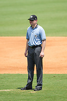 Umpire Mike Provine handles the calls on the bases during the Carolina League game between the Frederick Keys and the Winston-Salem Dash at BB&T Ballpark on July 30, 2014 in Winston-Salem, North Carolina.  The Dash defeated the Keys 12-2.   (Brian Westerholt/Four Seam Images)