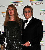 Roger Daltry, who is one of the 2008 Kennedy Center honorees, arrives with Heather Taylor, for the formal Artist's Dinner at the United States Department of State in Washington, D.C. on Saturday, December 6, 2008..Credit: Ron Sachs / CNP