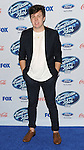 Alex Preston arriving at the 'American Idol XIII Finalists Party' held at Fig and Olive in Los Angeles on February 20, 2014