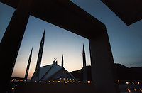 The Faisal Mosque in Islamabad is the largest mosque in Pakistan and the fourth largest mosque in the world. Completed in 1986, it was designed to resemble a Bedouin's tent. (1996)