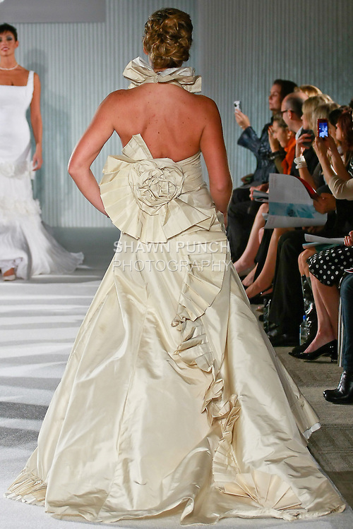 Model walks the runway in a Karen Hendrix Couture wedding Olivia dress by Karen Hendrix during the Wedding Trendspot Spring 2011 Press Fashion, October 17, 2010.