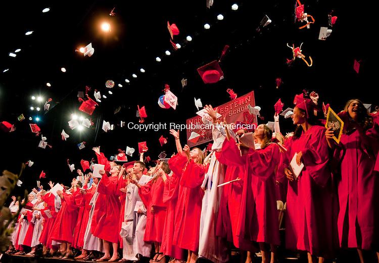 TORRINGTON, CT-061814JS13--Northwestern Regional High School graduates toss their caps during graduation ceremonies Wednesday at the Warner Theatre in Torrington. <br /> Jim Shannon Republican-American