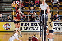 17 November 2011:  Denver outside hitter Cassie Ronda (11) hits a kill shot in the fourth set as the FIU Golden Panthers defeated the Denver University Pioneers, 3-1 (25-21, 23-25, 25-21, 25-18), in the first round of the Sun Belt Conference Tournament at U.S Century Bank Arena in Miami, Florida.