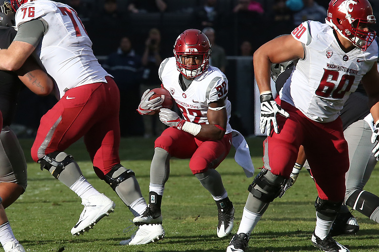 James Williams (32), Washington State running back, finds a huge hole to run through thanks to blocks by Cody O'Connell (72) and Andre Dillard (60) during the Cougars Pac-12 Conference road game battle between the leaders of the South and North Divisions with the Colorado Buffaloes on November 19, 2016, at Folsom Field in Boulder, Colorado.