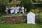 St Marys Church Kemsing Kent Uk. Kemsing was the birthplace in AD961 of Saint Edith of Wilton an illegitimate daughter of the Saxon King Edgar I. The well at the centre of the village is dedicated to her according to local legend her saintly presence has given the water healing properties. Annual pilgrimage to Well for unveiling of the Well Dressing plaque. September 2014.