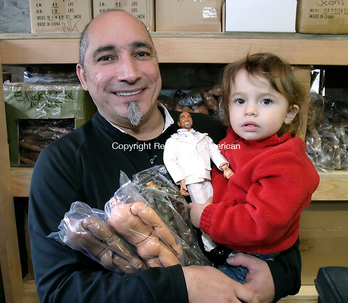 OXFORD, CT. 22 MARCH 2006- 032206BZ11- Emil Vicale holds both action figure bodies and his dauther Carolena Vicale, 18-months-old, (CQ) who in turn is holding an action figure with Emil's head on it at Herobuilders in Oxford.<br /> Jamison C. Bazinet Republican-American