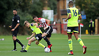 Canice Carroll of Brentford and Huddersfield Town's Scott High challenge for the ball during Brentford B vs Huddersfield Town Under-23, Friendly Match Football at Brentford FC Training Ground, Jersey Road on 12th September 2018