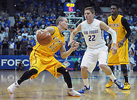 February 7, 2015 - Colorado Springs, Colorado, U.S. -  Wyoming guard, Josh Adams #14, pulls up at the top of the key during an NCAA basketball game between the University of Wyoming Cowboys and the Air Force Academy Falcons at Clune Arena, U.S. Air Force Academy, Colorado Springs, Colorado.  Air Force soars to a 73-50 win over Wyoming.