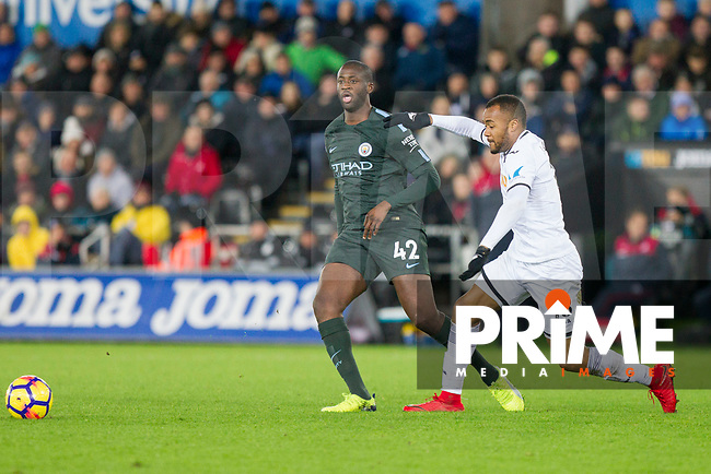 Yaya Toure of Manchester City and Jordan Ayew of Swansea City during the EPL - Premier League match between Swansea City and Manchester City at the Liberty Stadium, Swansea, Wales on 13 December 2017. Photo by Mark  Hawkins / PRiME Media Images.