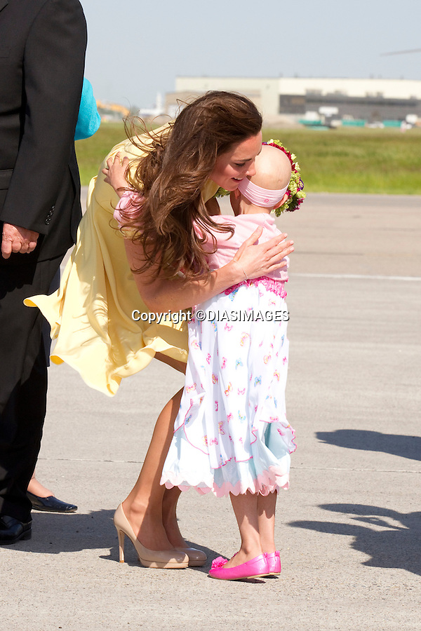 "PRINCE WILLIAM & KATE CANADA.7-year-old Diamond Marshall who is terminally ill hugs Kate on arrival at Calgary Airport, Alberta_07/07/2011.Mandatory Credit Photo: ©DIASIMAGES. .**ALL FEES PAYABLE TO: ""NEWSPIX INTERNATIONAL""**..No UK Usage until 03/08/2011.IMMEDIATE CONFIRMATION OF USAGE REQUIRED:.DiasImages, 31a Chinnery Hill, Bishop's Stortford, ENGLAND CM23 3PS.Tel:+441279 324672  ; Fax: +441279656877.Mobile:  07775681153.e-mail: info@newspixinternational.co.uk"