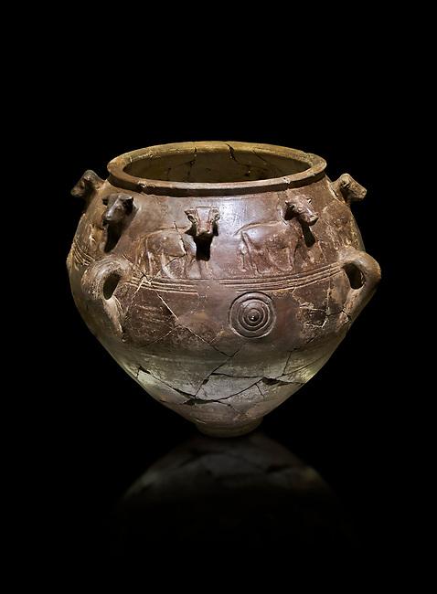 Bronze Age Anatolian relief Vase with bulls - 19th to 17th Century BC - Kültepe Kanesh - Museum of Anatolian Civilisations, Ankara, Turkey.  Against a black background.
