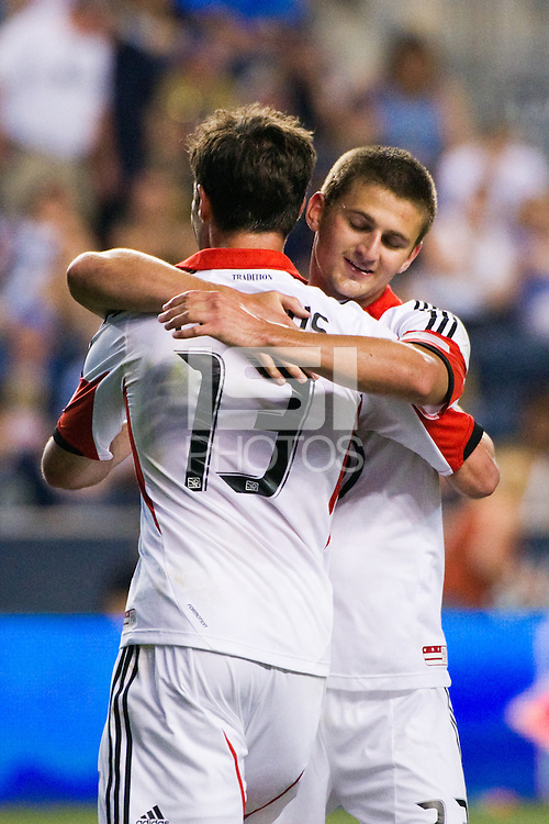 Chris Pontius (13) of DC United celebrates scoring with Perry Kitchen (23) during the second half against the Philadelphia Union. DC United defeated Philadelphia Union 1-0 during a Major League Soccer (MLS) match at PPL Park in Chester, PA, on June 16, 2012.