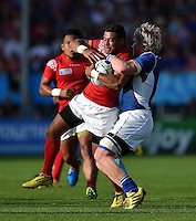Siale Piutau of Tonga is tackled by Renaldo Bothma of Namibia. Rugby World Cup Pool C match between Tonga and Namibia on September 29, 2015 at Sandy Park in Exeter, England. Photo by: Patrick Khachfe / Onside Images