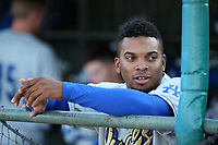 Yusniel Diaz (21) of the Rancho Cucamonga Quakes in the dugout before a game against the Lancaster JetHawks at The Hanger on April 20, 2017 in Lancaster, California. Lancaster defeated Rancho Cucamonga 4-0. (Larry Goren/Four Seam Images)