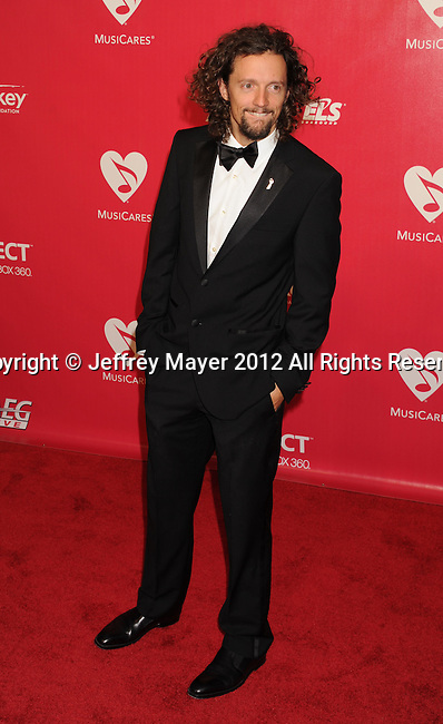 LOS ANGELES, CA - FEBRUARY 10: Jason Mraz arrives at The 2012 MusiCares Person of The Year Gala Honoring Paul McCartney at Los Angeles Convention Center on February 10, 2012 in Los Angeles, California.