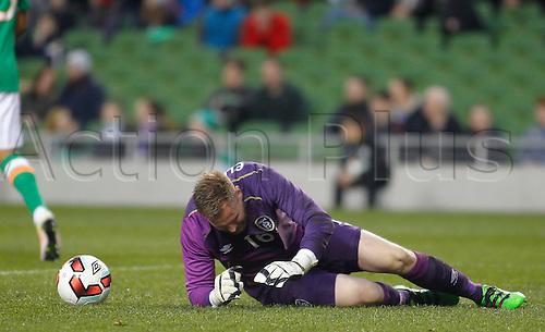 29.03.2016. Aviva Stadium, Dublin, Ireland.  International Football Friendly Ireland versus Slovakia. Rob Elliot (Rep. of Ireland) on the ground injured after the Slovakia goal in the 14th minute.