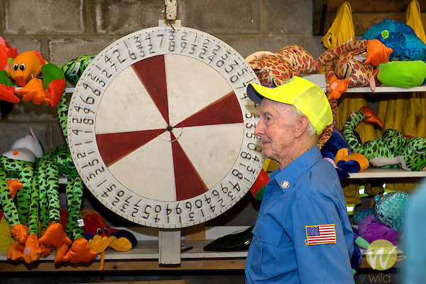Fireman's Carnival. Mr. Sullivan, 90 years. Spinning roulette wheel.