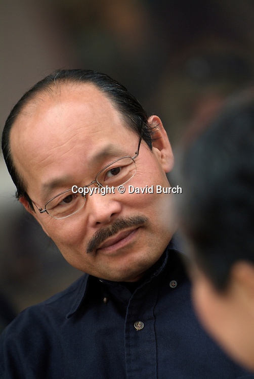 Asian man looking in conversation ,looking concerned