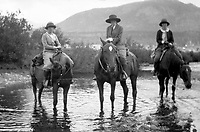 Three women on horseback in a stream in wetsern USA, circa 1930's.  (photo: www.bcpix.com)