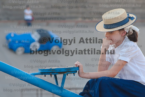 Girl in contemporary dress attends a hIstoric car race in Budapest, Hungary on September 17, 2011. ATTILA VOLGYI