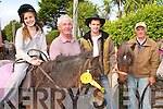 ALL SMILES: Siun, Tom and Pat Hennessy from the Maharees with Laurence O'Connor enjoyed Camp Sheep Fair on Monday afternoon.