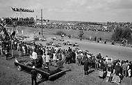 Watkins Glen, New York State, USA. 01 Oct 1967. Crowds watch the start of the race as Formula One racecar drivers compete in the 1967 Watkins Glen Formula One Grand Prix.