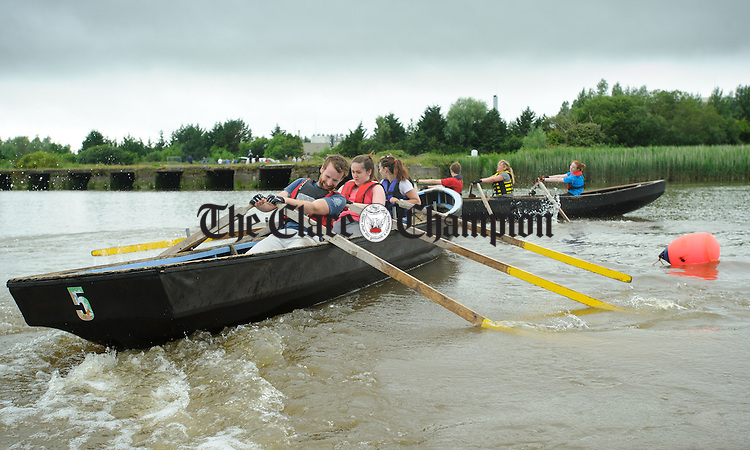 Sinead Cusack, Michaela Mc Namara and Keith Ranalow taking part in the Currach Racing at the annual  Clarecastle Regatta. Photograph by John Kelly.