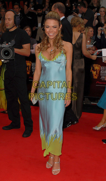 ADELE SILVA.Arrivals at the Pioneer British Academy Television Awards 2006 at the Grosvenor House Hotel, London, UK..May 7th, 2006 .Ref: CAN.BAFTA TV.full length blue satin dress green.www.capitalpictures.com.sales@capitalpictures.com.©Capital Pictures
