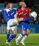 Steven Naismith gets a kick in the ribs from David Lilley