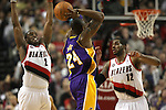 04/08/11--Blazers' Wesley Matthews and LaMarcus Aldridge closely defend Lakers' Kobe Bryant in Portland's 93-86 win over  L.A.  at the Rose Garden..Photo by Jaime Valdez........................................