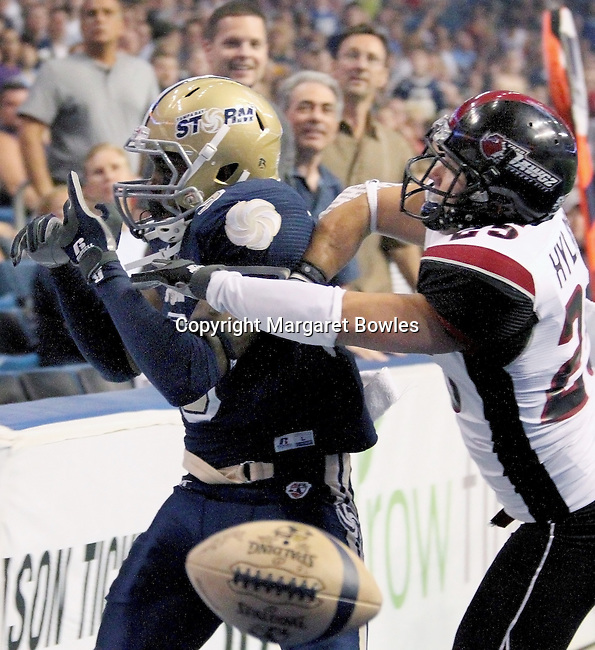 05 June 2010: Oklahoma City defensive back David Hyland knocks the pass out of the hands of Tampa Bay receiver Hank Edwards. The Tampa Bay Storm defeated the Oklahoma City Yard Dawgz 50-48 at the St. Pete Forum in Tampa, Florida