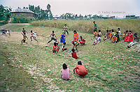 Children from the village of Kalinagar play together in the field behind their village. Many of them, particularly girls, attend classes on boat schools. (Photo by Tadej Znidarcic)