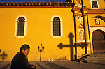A woman walks in front of the historic San Cristobal Cathedral in Chiapas, Mexico.