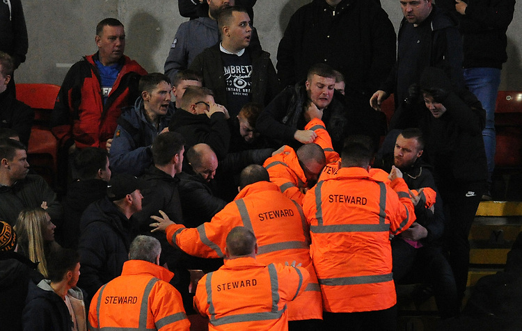 A fight breaks out between Bolton Wanderers fans and stewards<br /> <br /> Photographer Kevin Barnes/CameraSport<br /> <br /> The EFL Sky Bet League One - Bolton Wanderers v Blackpool - Monday 7th October 2019 - University of Bolton Stadium - Bolton<br /> <br /> World Copyright © 2019 CameraSport. All rights reserved. 43 Linden Ave. Countesthorpe. Leicester. England. LE8 5PG - Tel: +44 (0) 116 277 4147 - admin@camerasport.com - www.camerasport.com