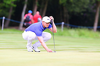 Oliver Fisher lines up his putt on the 4th green during the BMW PGA Golf Championship at Wentworth Golf Course, Wentworth Drive, Virginia Water, England on 28 May 2017. Photo by Steve McCarthy/PRiME Media Images.